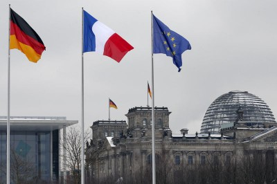 German French and EU flags flutter over the German lower house of parliament in Berlin